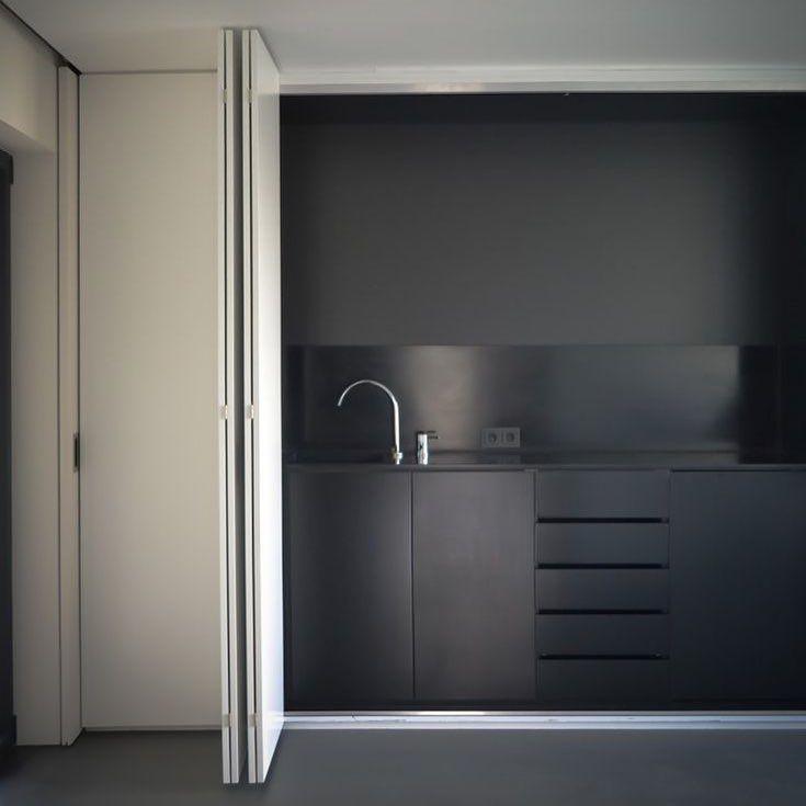 Minimal sober black kitchen. Interior