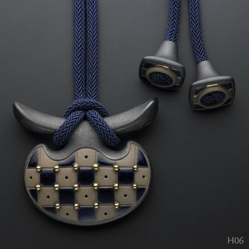 Istvan Hollo's stoneware pendant. Ceramic Pendant. Poured coloured stoneware, glaze, gold, cotton cord. Click through to his Tumblr site.