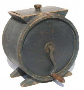 Antique table top butter churn in old paint.