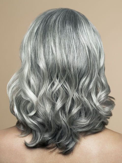 Coloring hair smooths out the cuticle, so you'll need to add a little more polish to gray hair once you've stopped dying it all over. Use a shine-enhancer or smoothing product daily.