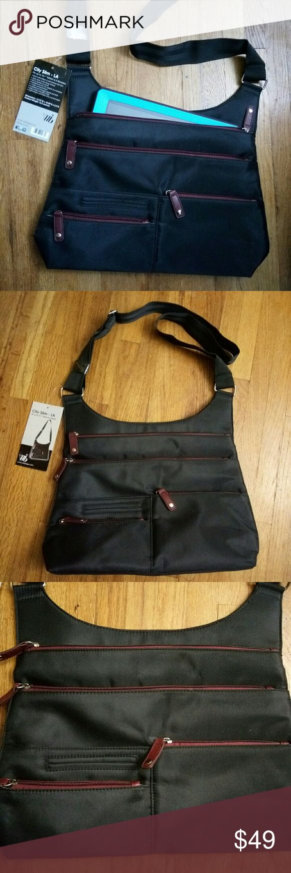 """LA City Slim Tablet Laptop Bag Black BRAND NEW WITH TAGS! (Tablet not included)  The LA City Slim is designed for the urban professional on the go.The City Slim can be worn across the body or over the shoulder.  It is the perfect accessory for running out to do errands around the city or to grab a quick business lunch.Compatibility: Fits up to a 10"""" Tablet, iPad, iPad2, iPad3, Samsung Galaxy up to 10 All Kindle Products including Kindle Fire.  We ship same day or next. Thank you for shopping…"""