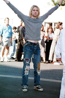 Ripped jeans enjoyed a fashion moment in the the 90s. Here's the late Kurt Cobain modelling a great grunge look. All he needs is an oversized cardi or plaid shirt...