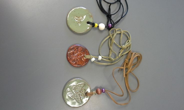 Beautiful Clay Pendants, Leather and Beads - Handmade Jewelry by Ulrike Schneider. Available in the Gallery Shop for $18.50