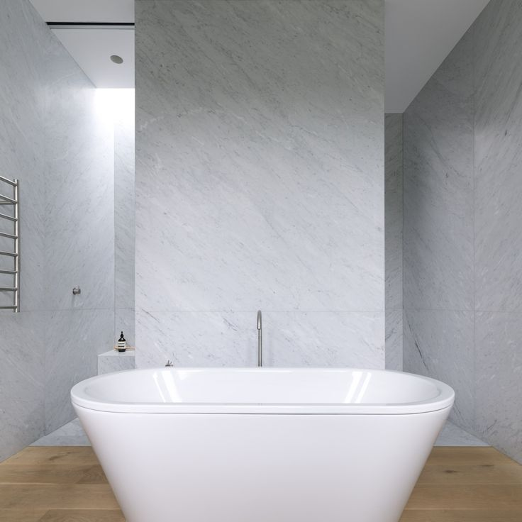Tobias Partners - Cooper Park House. In the main bathroom, Kaldewei 'Centro Duo' bath from Candana. Walls are covered in imported marble.
