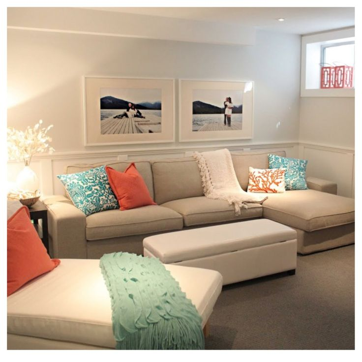 Teal and orange with beige furniture and black/white pictures in white frames. I think they did an awesome job of making this basement a cozy space. #apartment #home #decor