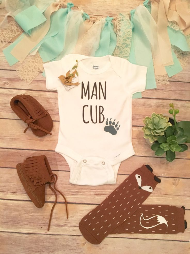 "Man Cub Onesie® (or T-Shirt) Cute baby boy bodysuit or t-shirt with ""MAN CUB"" across the front inside with a bear paw silhouette. Perfect for your newest little cub. Your little bear cub will be so on"