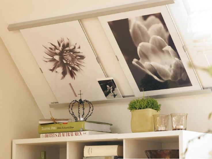 pictures on wall under roof