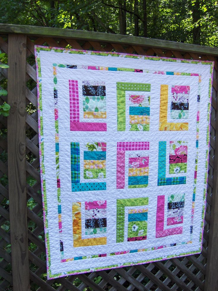 https://flic.kr/p/afs67m   Aubrey's Quilt   Made for my 11 month old granddaughter , Aubrey Kate.  My husband worked out the design!  Machine pieced and quilted.