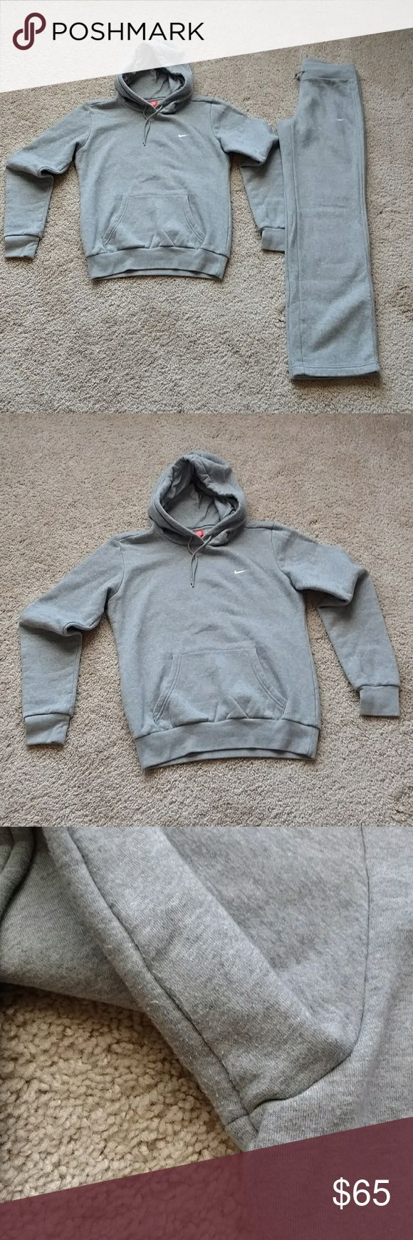 Authentic NIKE sweat suit Pull over hoodie and pants.  Hoodie is size small with minor piling under arms but in excellent condition. No stains. Pants are size xsmall with minor piling in crotch area. No stains.  Light gray sweats and pull over with drawstring hoodie to tighten. Check color: white Nike Other