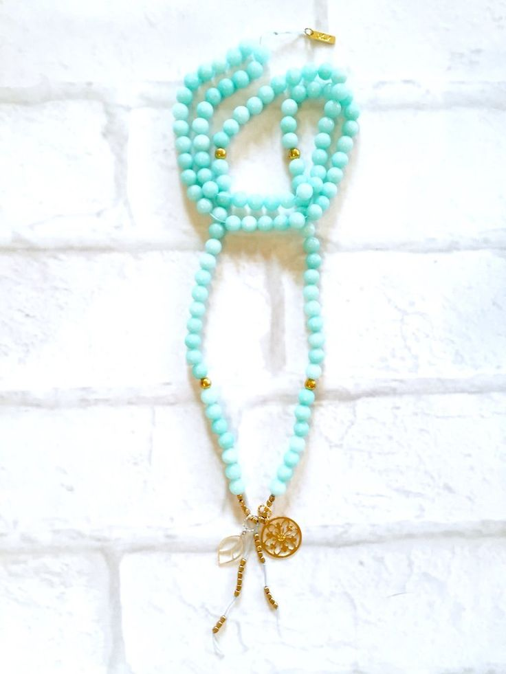 Amazonite Mala Necklace Intentional jewelry made with amazonite gemstones and sacred geometry pendents. Used during meditation, yoga practice or simply worn as a beautiful piece of jewelry. Each gemstone hold unique healing properties and can be used as a daily reminder of your positive intentions.