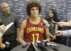 Cavaliers center Anderson Varejao left training camp Tuesday following his grandfather's death. Varejao talks with reporters during Cleveland's media day in Independence, Ohio, on Monday.
