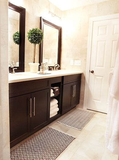 Vanity with open shelving in center - brown shaker doors with sleek hardware, cool topiary!