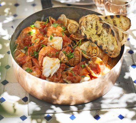 Mediterranean fish stew with garlic toasts