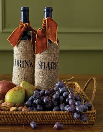 Hostess Gift - A scrap of rustic burlap, wrapped around a regional wine and topped with a lush remnant of velvet ribbon, is elevated to the truly elegant. Stencil the hostess's initials or a short greeting