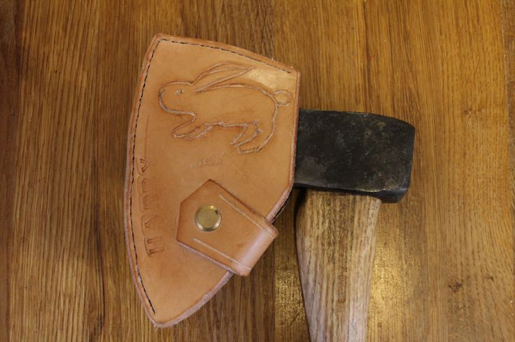 Carved leather axe head cover