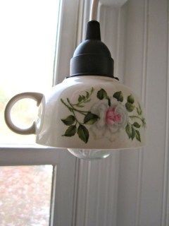 Tea cup lamp .. would be sweet in a trailer.    Use smaller bulbs and hang several...