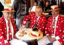 Swiss people dress up to celebrate important events such as Switzerland's national day on August 1st. They enjoy cake and other rich desserts on this special occasion while dressed in the country's flag color.