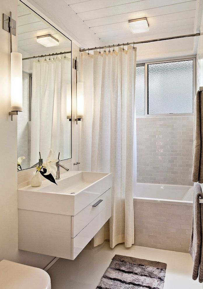 """This bathroom is approximately 5' W x 8'-6"""" L.   Heath tile appears to be 2x4 tile G107 Mid Century   Boxie Ceiling light from Tech Lighting   The sconces are made by Neidhardt   The sink and vanity is by Burgbad Crono   Duravit /Starck tub in white   The flooring is resin   Carmel Mid-Century Residence by Studio Schicketanz"""
