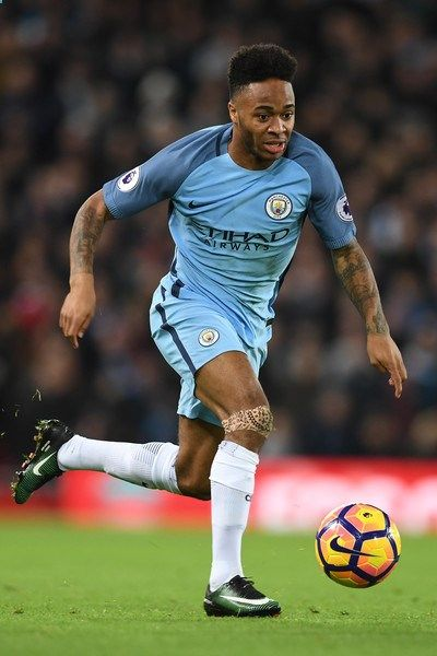 Manchester Citys English midfielder Raheem Sterling runs with the ball during the English Premier League football match between Liverpool and Manchester City at Anfield in Liverpool, north west England on December 31, 2016. / AFP / Paul ELLIS / RESTRICTED TO EDITORIAL USE. No use with unauthorized audio, video, data, fixture lists, club/league logos or live services. Online in-match use limited to 75 images, no video emulation. No use in betting, games or single club/league/player publ...