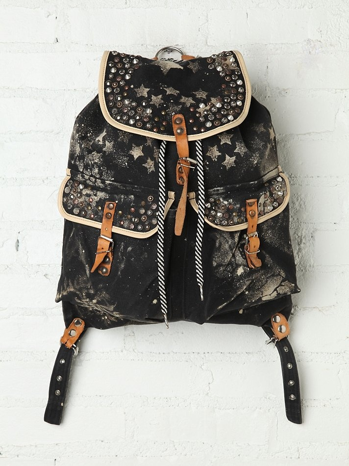 Free People Vagabond Backpack - Spray paint patterned distressed canvas backpack with stud embellishment. Reconstructed from an actual vintage backpack in NYC. Because each backpack is handmade and made from vintage materials, they may vary and no two will be exactly alike.