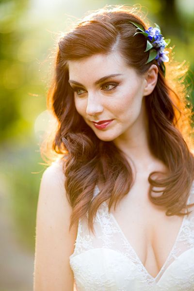 Simply moving the part off to the side gives this innocent look adorned with flowers a bit of a sexy edge. Let your hair hang below in loose waves for a Boho feel that would make Lauren Conrad swoon. Related: Gorgeous Ways To Wear Your Hair Down For Your Wedding