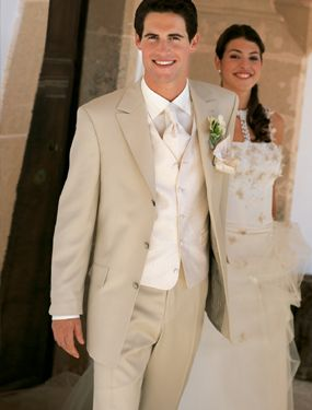 tan with white inner vest and matching white tie. like this look