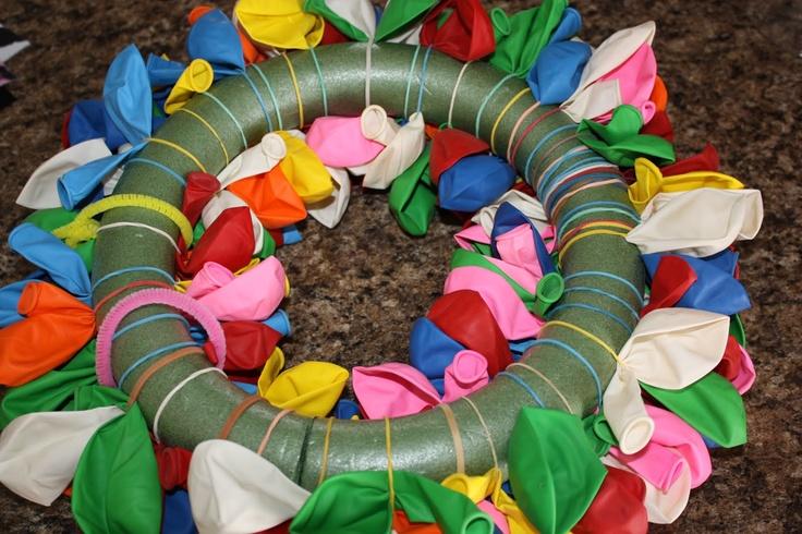easy birthday wreath...cut the styrofoam wreath, add rubber bands, glue wreath together and add balloons.