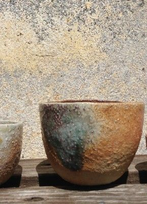 Pinched cup , wood/soda fired