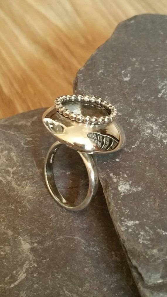 Check out this item in my Etsy shop https://www.etsy.com/uk/listing/289382905/statement-oxidized-ring-modern-bead-trim