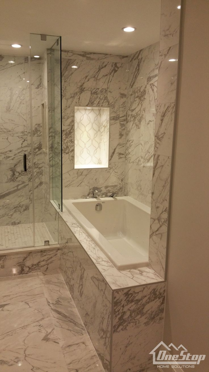 Custom designed marble bathroom with floating vanity and glass door shower- Toronto | One Stop Home Solutions