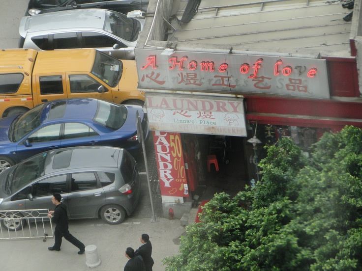 Home of Love.  Chinese laundry and tourist shop.
