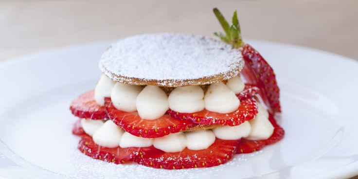 Vanilla-infused strawberries and a macadamia nut praline add another dimension to Adam Byatt's take on a classic mille-feuille dessert. This elegant layered pastry dish makes a perfect summer pudding and makes the most of deliciously ripe strawberries.
