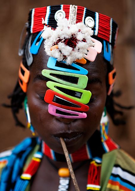 """Tribal Girl, Omo Valley, Ethiopia RK - interesting that her """"village dress"""" is with plastic barrettes."""