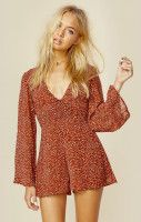 """Wyldr's Lead The Way Playsuit features an animal print throughout, deep V neckline, hidden front zipper, and long bell sleeves.  ImportedDry Clean OnlyPoly BlendFit Guide:Model is 5ft 9 inches; Bust: 32"""", Waist: 24"""", Hips: 34""""Model is wearing a size XSRelaxed FitShoes Featured Not Available For Purchase"""