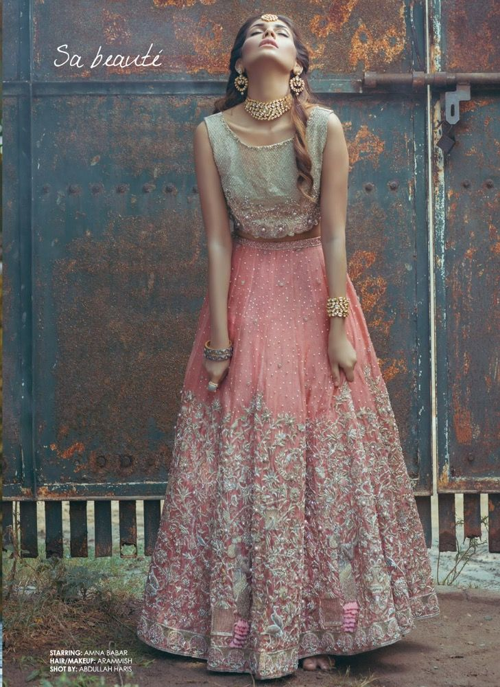Lovely pastel colours in this pale blue and pink heavy embroidered lehenga (crop top and maxi skirt combo). But a quite a strange pose... #apoorvatailoring