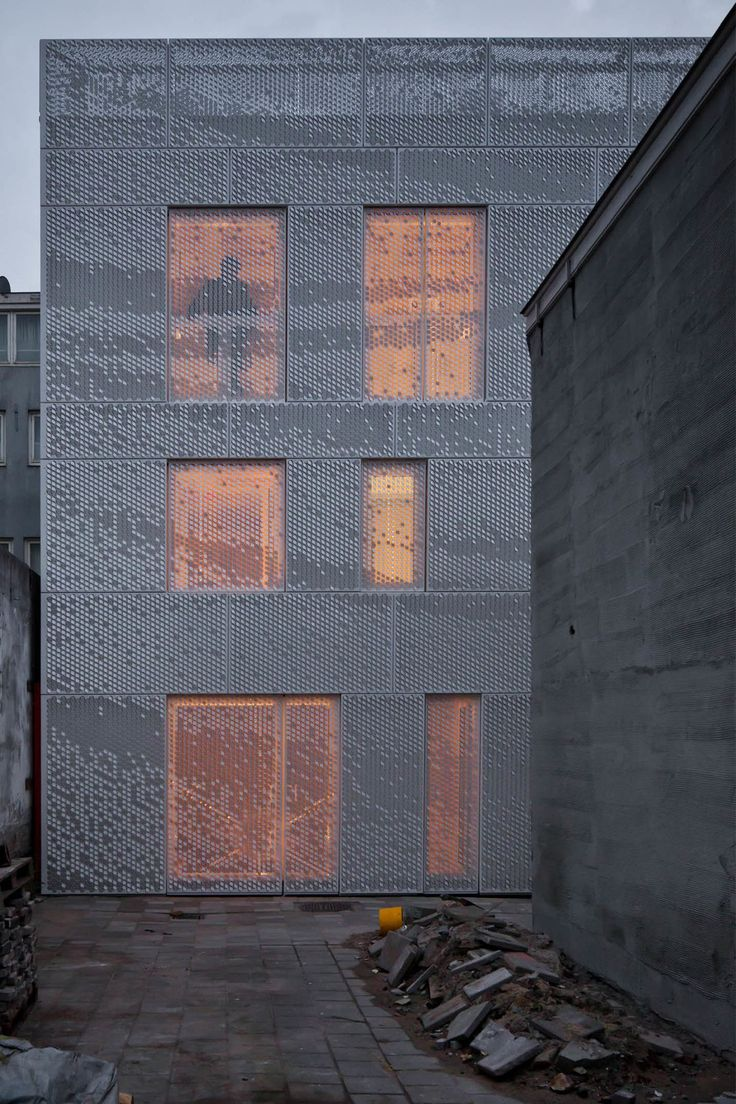 Façade design for a residential building by Abbink X de Haas architects and housing cooperation de Key in the center of Amsterdam. Aluminum sheets are perforated with a pattern that allows the shapes to be bent up or down. When bent up the surface catc...