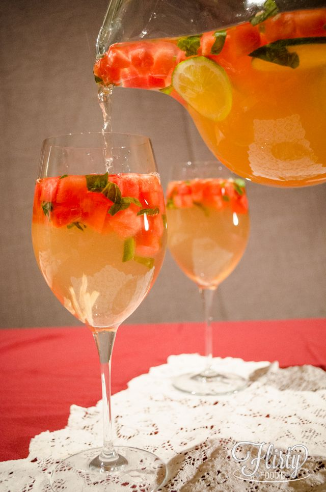 sunset sangria - white wine; cointreau; white grape juice; club soda; fresh watermelon; fresh ginger; fresh sweet basil; lime slices