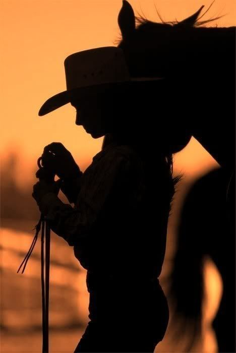 Cowgirl riding silhouette