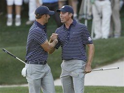 USA's Matt Kuchar, right, and Dustin Johnson celebrate after winning the 17th hole during a four-ball match at the Ryder Cup PGA golf tournament Saturday, Sept. 29, 2012, at the Medinah Country Club in Medinah, Ill. (AP Photo/Charles Rex Arbogast)