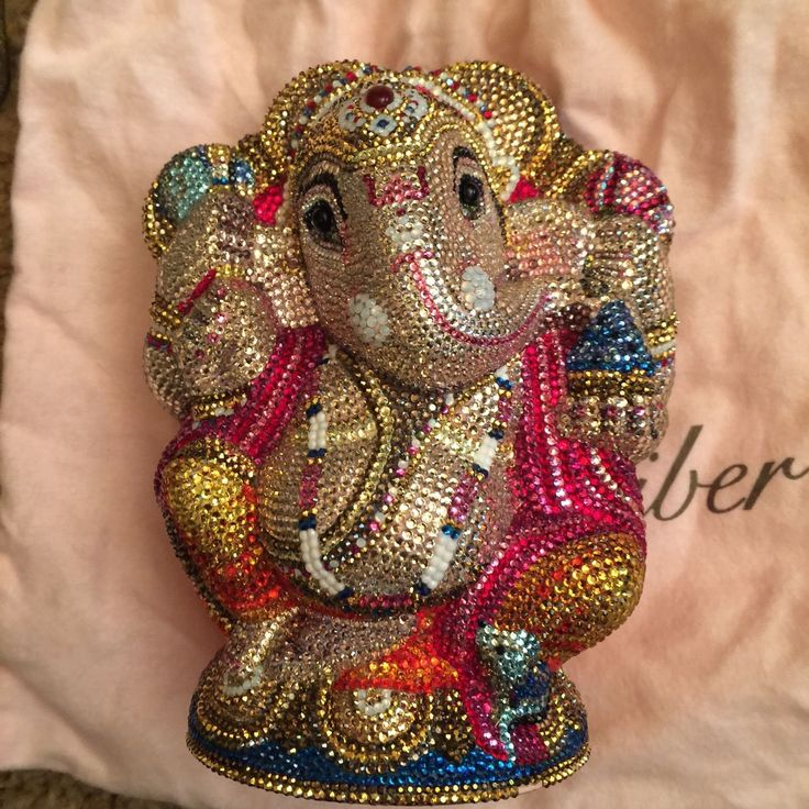 This is an authentic JUDITH LEIBER Austrian Crystal Ganesh Elephant Minaudière Clutch. This stunning clutch is in the form of a Hindu elephant and with all the colors in brilliant Austrian crystals.   eBay!