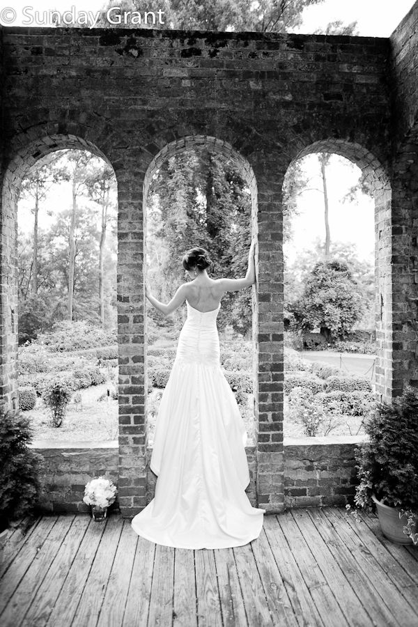 Bridal portrait framed inside the ruins of Barnsley Gardens