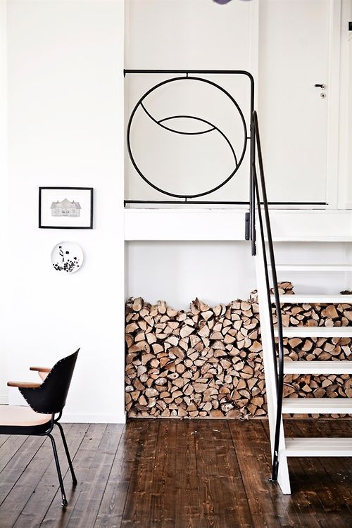 love the wood under the stairs storage idea