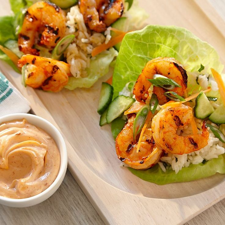 Cool fresh lettuce leaves make a great wrapping for grilled shrimp and cilantro flecked rice. Include the fresh vegetable toppings to add crunch and a drizzle of Sriracha Mayo for heat.