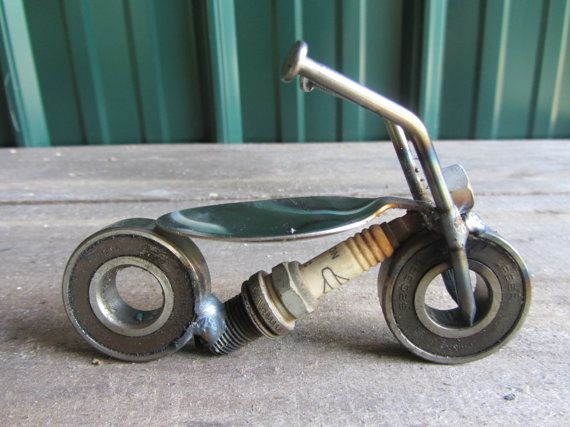 """This cute little motorcycle has ball bearings for wheels , nails for handle bar, spoon for a seat.  This Item * Piece: Metal motorcycle Height: approx 3 inches Width: approx 1.5 Inches Length: approx 5 inches Weight: approx 1.5 lbs   * Please Note *  All of our metal art is handcrafted using various recycled / re purposed scrap metal mediums. In most cases each piece is made to order, and may vary slightly from the photo shown in the listing. This helps preserve the """"one of a kind"""" piece..."""