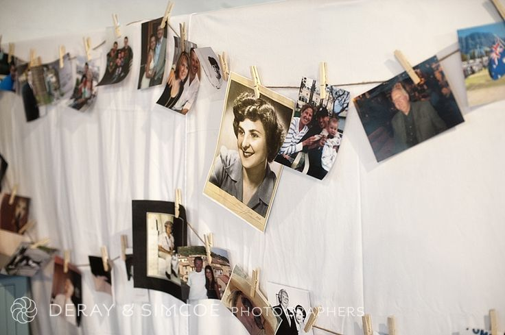Vintage family photographs and Polaroids strung together with wooden pegs and twine