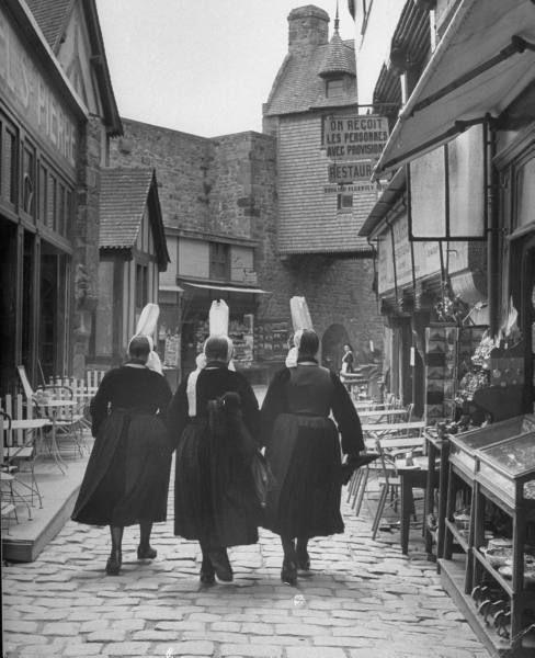 Women walking down Rue de la Paix. Photograph by Eliot Elisofon. Cherbourg, France, September 1948.