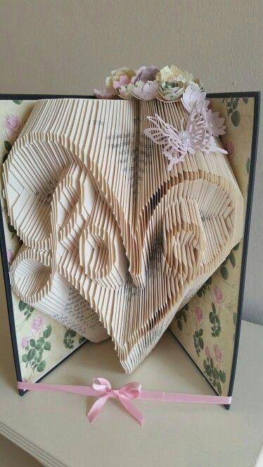 Swirly love book fold                                                                                                                                                     More