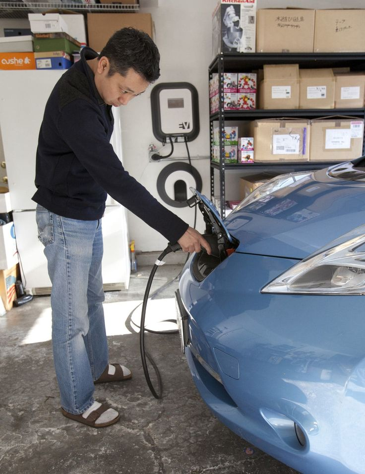 Shinya Fujimoto uses an Electric Vehicle charger for his Nissan Leaf that is installed in his Fremont, California, home.