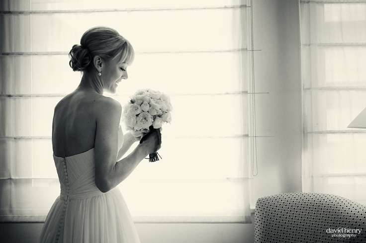 Bride delighting in her flowers