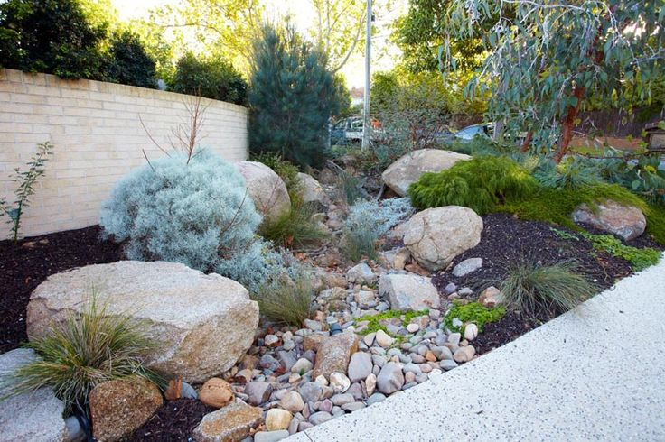 rocks, native grasses, dry river bed to direct floodwater